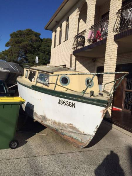 9 meter long wooden boat