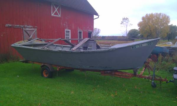 old wood fishing/duck boat that is free