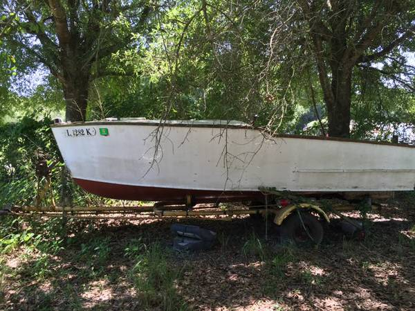 Old homemade wooden boat. Needs work to be sea worthy.