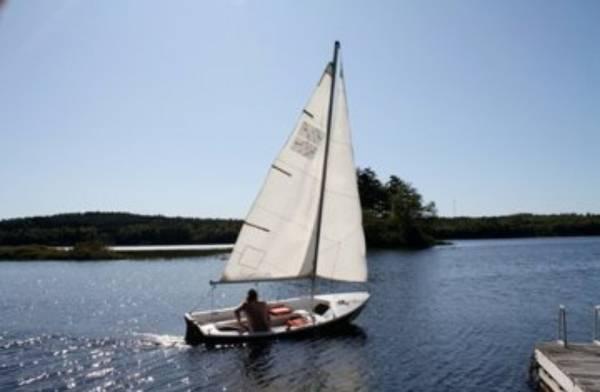 13' sloop. Chrysler LS 13  on the water