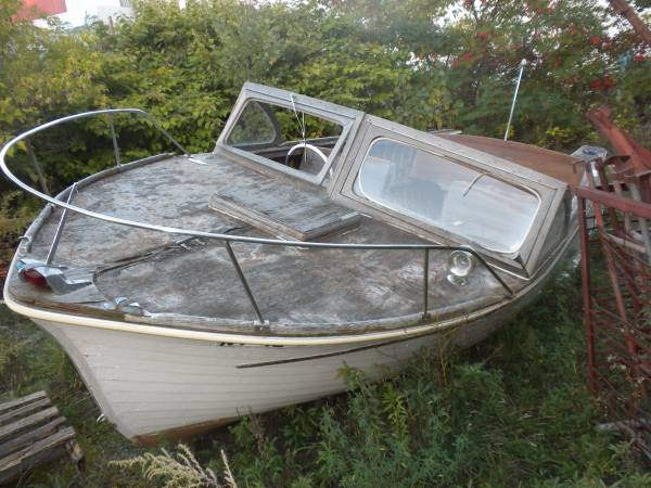 Thompson wood boat to a good home