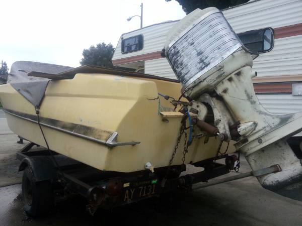 yellow project boat and trailer