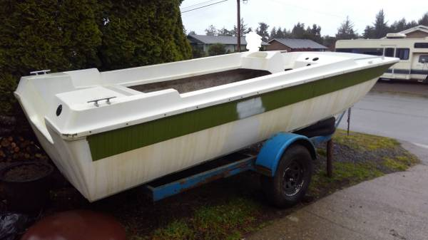 18' fiberglass tri-hull boat and trailer starbird side stern view
