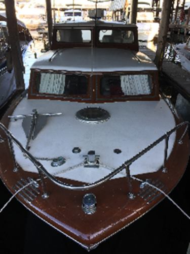 35' classic wood hull cabin cruiser on the bow
