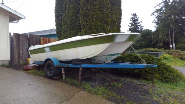 18' fiberglass tri-hull boat and trailer side view