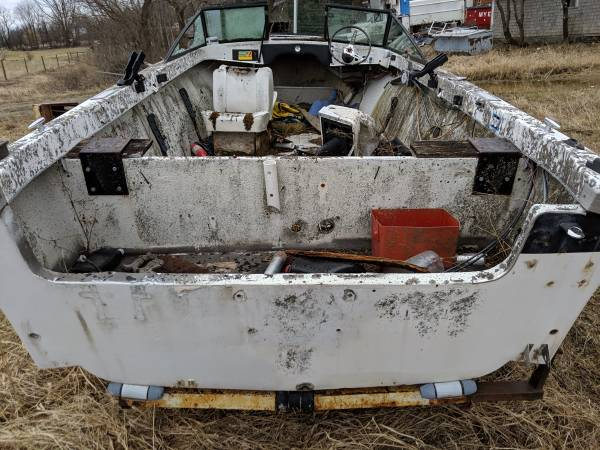 Small power boat on trailer see stern