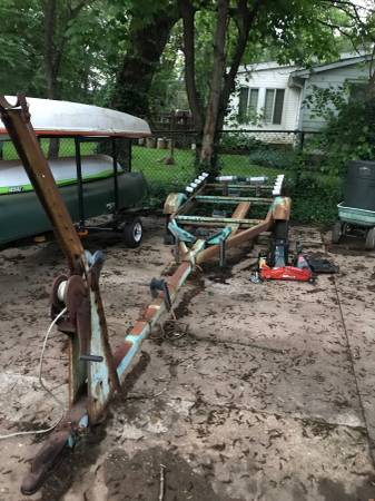 17 foot trailer and sailboat with stands