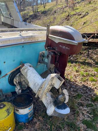 older chris craft style boat with engine